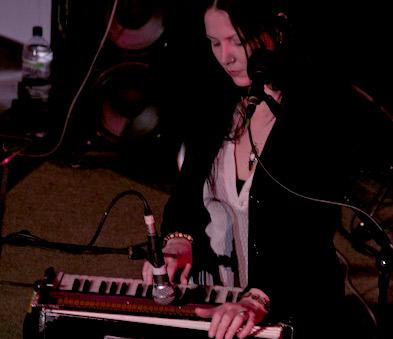 Eliza Skelton pumps organ